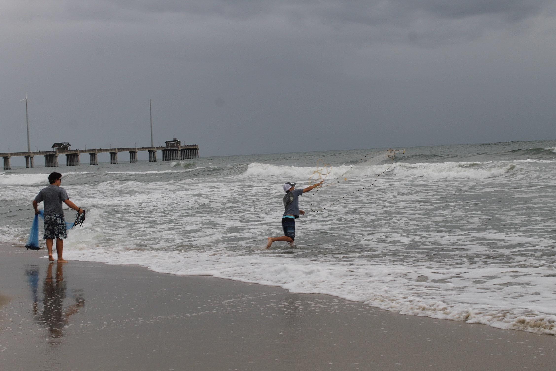Student Throwing Net into Ocean
