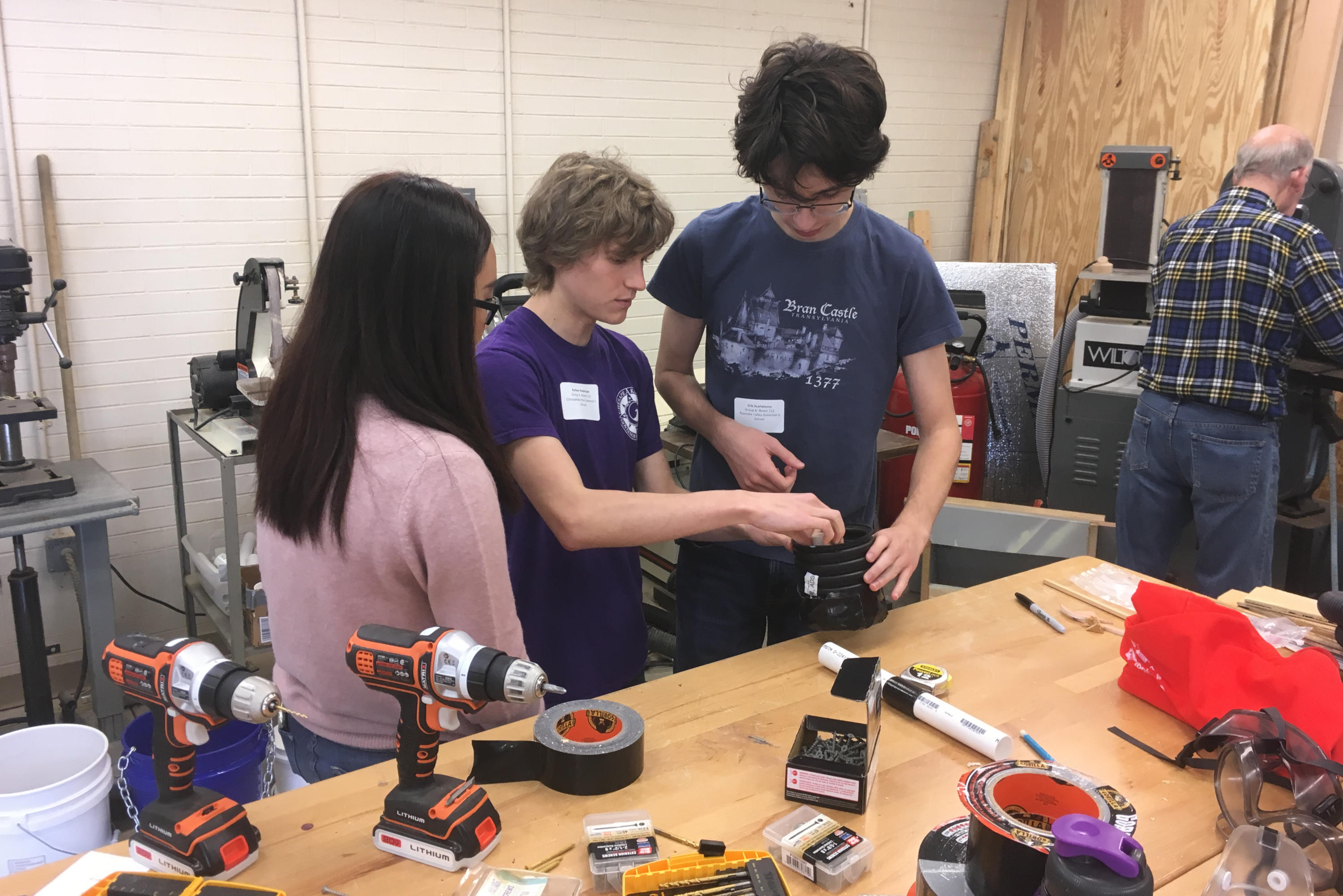 Students building a project with tools